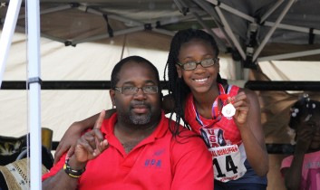 Coach Norwood with Brooke M. AAU Region 15 Multi-Event Champion!